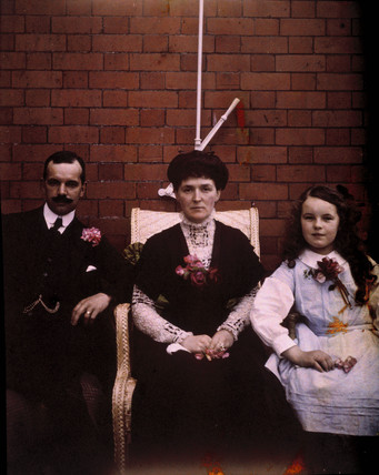 Autochrome of  Hugh, Ethel and Kathleen sitting, c 1910.