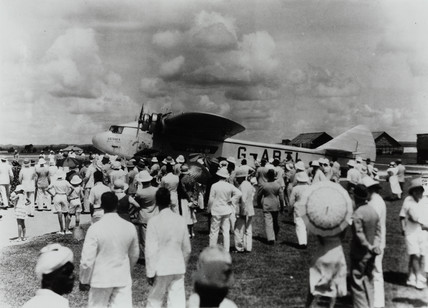 Large crowd waiting to greet G-ABTL 'Astraea' arriving in the Far East , c 1932.