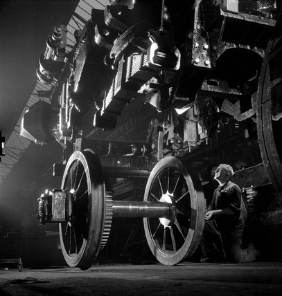 Diesel train chasis is lowered on to wheels, English Electric, Preston, 1956.