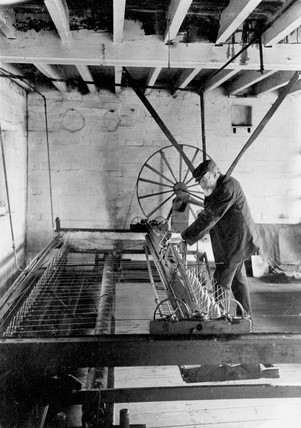 A Spinning Jenny in use at Palmer Mackay Limited, Trowbridge, c 1930.
