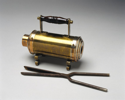 Crompton electric curling tong heater with tongs, 1891.