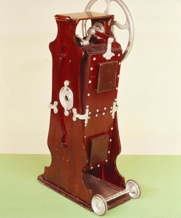 'Wizard' hand-operated bellows domestic vacuum cleaner c 1911.