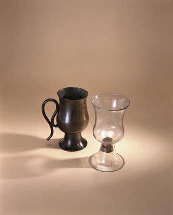 Copper syphon or 'Tantalus' cup, and glas, early 18th century.