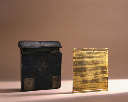 Pocket clinometer and square in an embosed leather case, c 1675-1700.