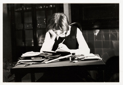 Schoolgirl doing her homework, c 1935.