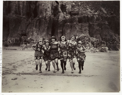 Women running on a beach, c 1925.