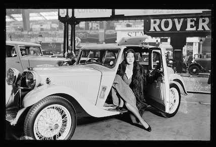 Woman in a sports car at the Olympia Motor Show, 1932.