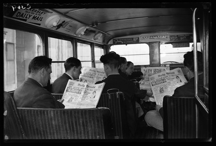 Bus passengers reading the Daily Herald newspaper, 1933.