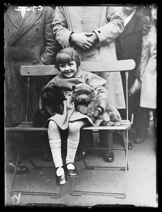 Little girl with two puppies, 1934.