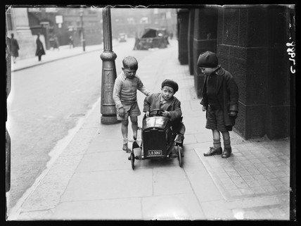 Children with a go-cart, 1934.