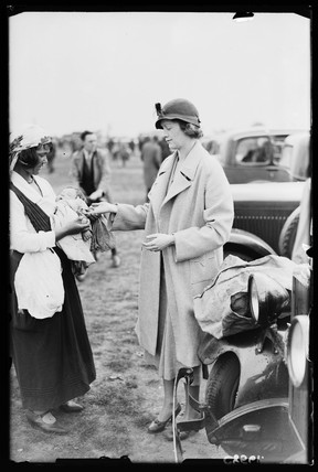Palm-reading at the races, 1934.