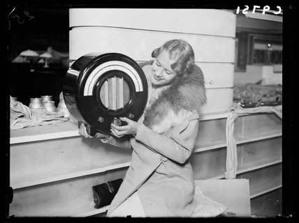 Woman holding an Ekco radio, Radiolympia, London, 1934.