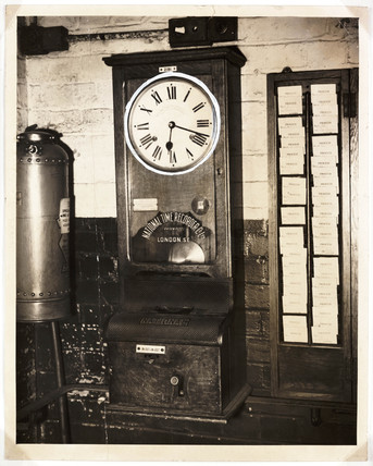 Clocking on machine, 1949.