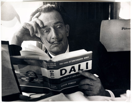 Salvador Dali reading his biography, 6 May, 1959.