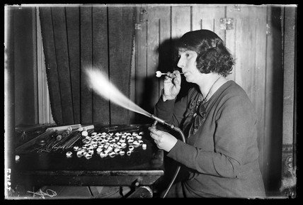 Woman making glas eyes, 1935.