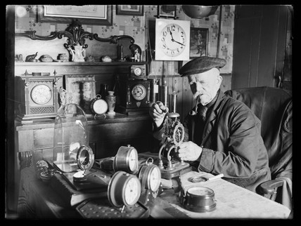 Charlie Rolfe and his clocks, Essex, 1944.