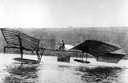 Glenn Curtiss flying the modified Langley 'aerodrome' .
