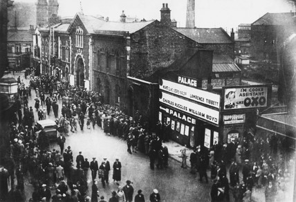 Audience leaving the Palace cinema, Wigan, Lancashire, c 1936.