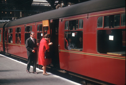 Two passengers getting onto a train, Liverpool Street station, London, 1963.
