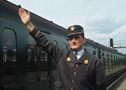 Forman signalling to train, April 1964.