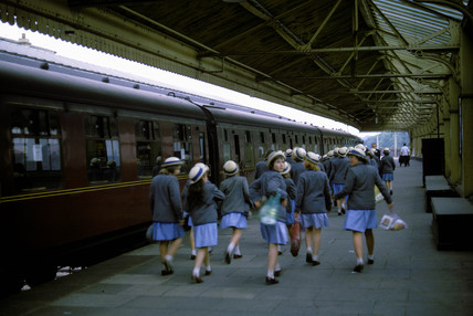 Schoolgirls walking along station platform, Windsor, Berkshire, 1966.