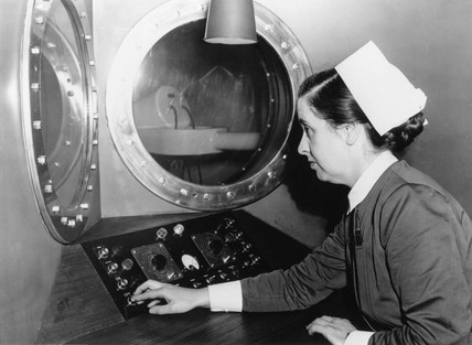 Nurse operating a radiotherapy machine, Bristol General, 1954.