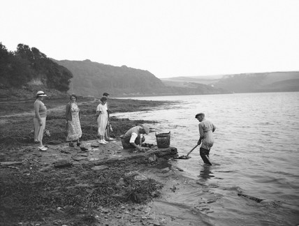 Oyster fishers watched by tourists, Percuil, Cornwall, 1937.