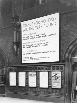 Advertisement for holidays to France at St Pancras Station, London, 1939.