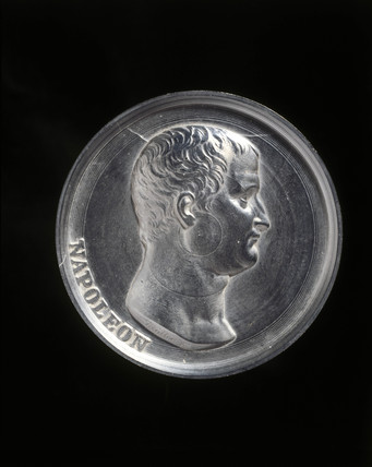 Casein plaque with moulded head of Napoleon Bonaparte, c 1900.