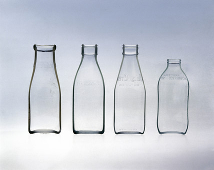Four milk bottles.