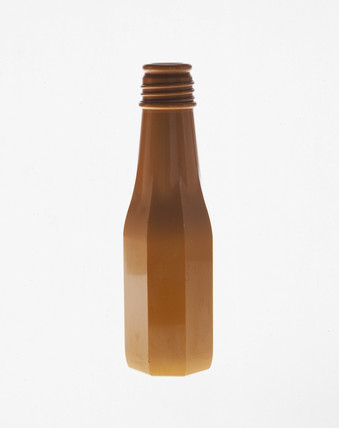 Model bottle in Catalin, used as an aid to bottle design, 1950-1965.
