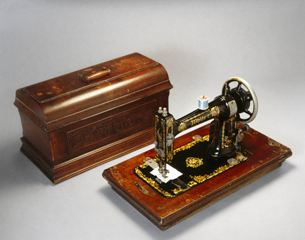 White sewing machine with case, 1890-1900.
