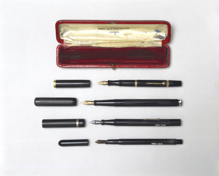 Four fountain pens with case, 1896-1940.