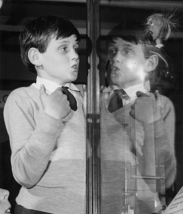 Boy with  Van de Graaff generator exhibit at  Science Museum, London, 1964.