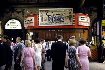 Passengers inside Victoria Station, London, 1965.