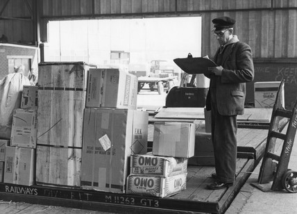 Clerk checking goods on a British Rail wagon, Stoke, c 1960s.