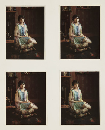 Girl sitting on a cushion, c 1920s.