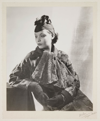 Seated woman in a fur coat, c 1930.