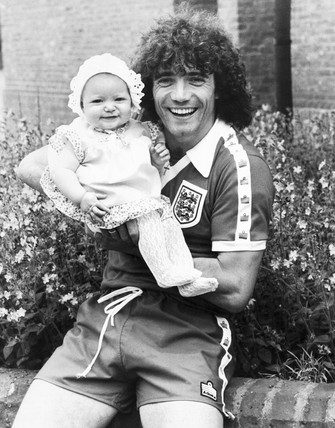 British footballer Kevin Keegan with daughter Laura, June 1979.