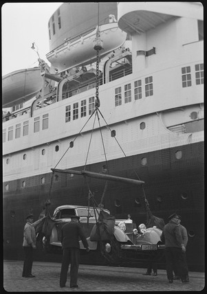 Mercedes-Benz being transported onto a ship by crane, 1934.