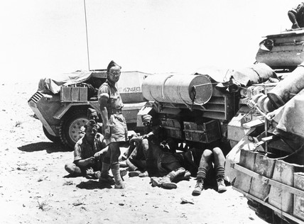 British sodiers resting by their tanks in Libya, 11 July 1946.