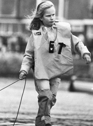 Zara Phillips makes fast a sailing dinghy, October 1988.