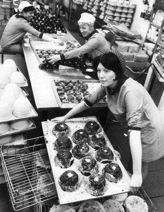 Women wrapping Christmas puddings, Heanor, Derbyshire, June 1971.