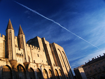 Vapour trail over the Palais des Papes, Avignon, France, 2004.