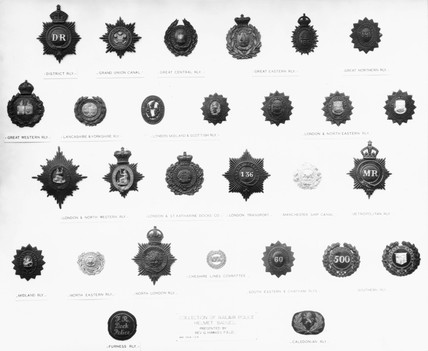 Railway police helmet badges.