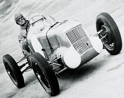 Sir Malcolm Campbell racing at Brooklands, Weybridge, Surrey, 1935.