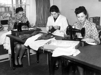 Women sewing shirts, 31 October 1939. 'A su