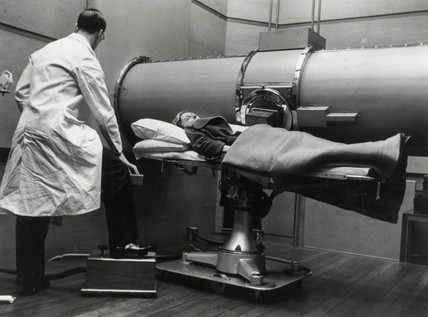 An x-ray being taken at Bartholomew's Hospital in London, c 1930s.