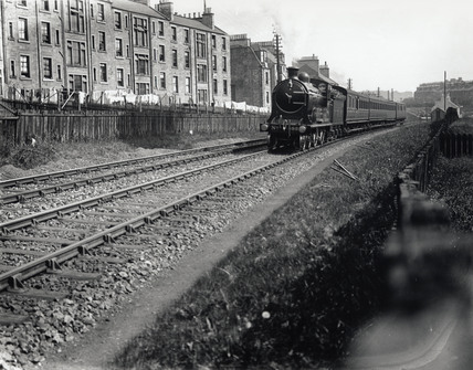 A North British Railway local passenger train, near Hawick, Border, c 1910.