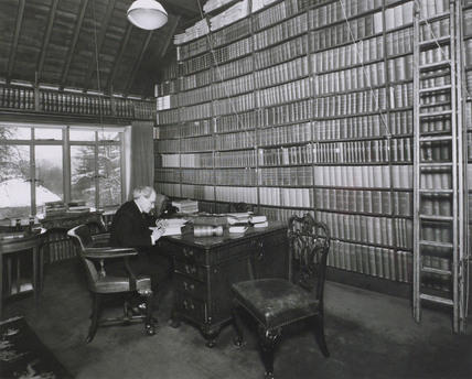 Dr Oswald John Silberrad in his library, Loughton, Essex, 1947.